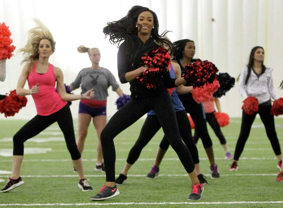 Texans cheerleader Lesha dances during Cheerba, a fitness workout by Texans cheerleading coach Alto Gary. Photo: Karen Warren, Staff / © 2014 Houston Chronicle