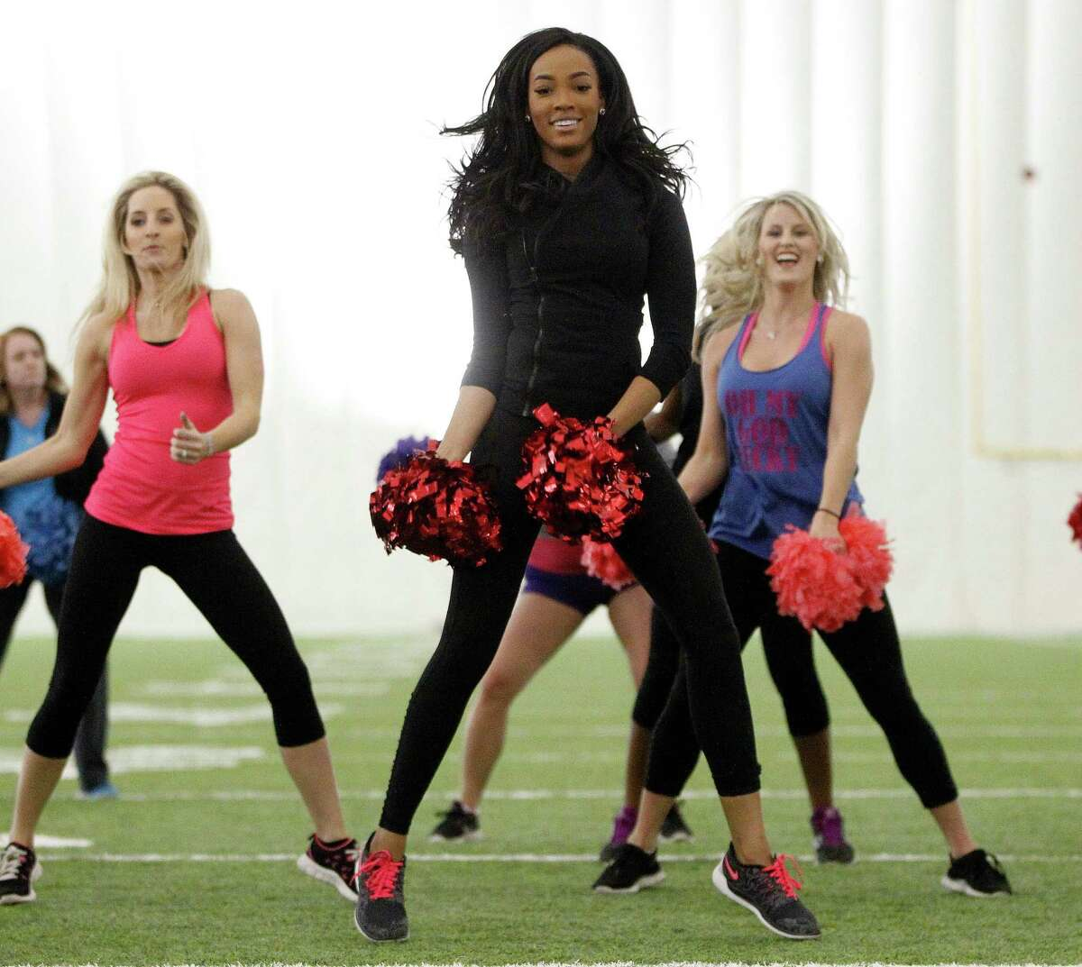 Current Houston Texans cheerleader Lesha dances with others during Cheerba, a fitness workout by Texans' cheerleading coach Alto Gary at the Houston Texans Methodist Training Center (aka