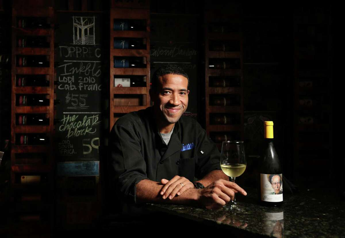 Chris Williams with his wine of choice at Lucille's on Monday, Jan. 12, 2015, in Houston. ( Mayra Beltran / Houston Chronicle )