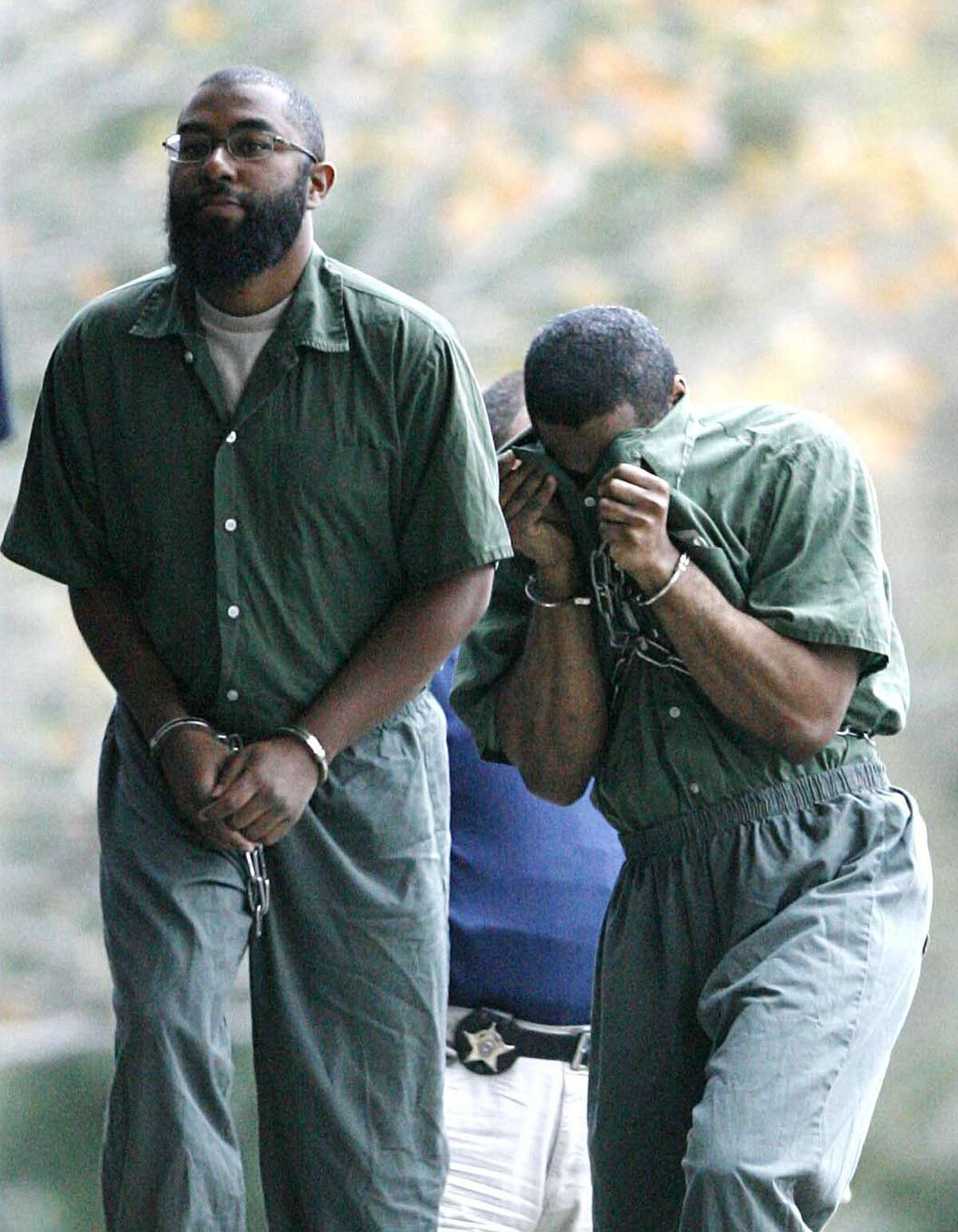 (l-r) Kobie Diallo Williams, also known as Abdul Kabir, (cq) who is charged with conspiring to join the Taliban and fight against U.S. forces, enters the Federal Courthouse, Along with Tyrone Williams (cq) Wednesday December 6,2006, in Houston, Texas, today begins the sentencing phase, for Tyrone Williams who was found guilty on all 58 counts on Monday, Dec. 4, 2006 for his role in the deaths of 19 illegal immigrants who were sealed inside his trailer in 2003. ( BILLY SMITH II/STAFF)
