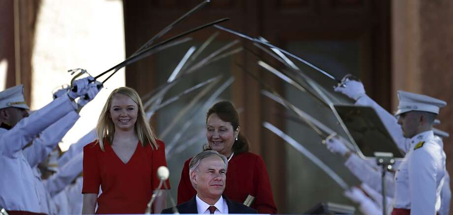 Gov. Greg Abbott enters the stage for the Inauguration Ceremony of Texas Governor Abbott and Lieutenant Governor-elect Dan Patrick in Austin, Texas.  Tuesday, Jan. 20, 2015. Photo: San Antonio Express-News