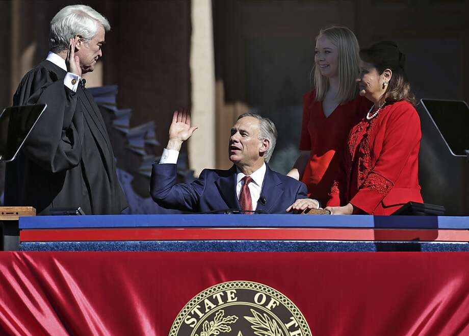 Greg Abbott takes the oath of office during the Inauguration Ceremony of Texas Governor-elect Abbott and Lieutenant Governor-elect Dan Patrick in Austin, Texas.  Tuesday, Jan. 20, 2015. Photo: San Antonio Express-News