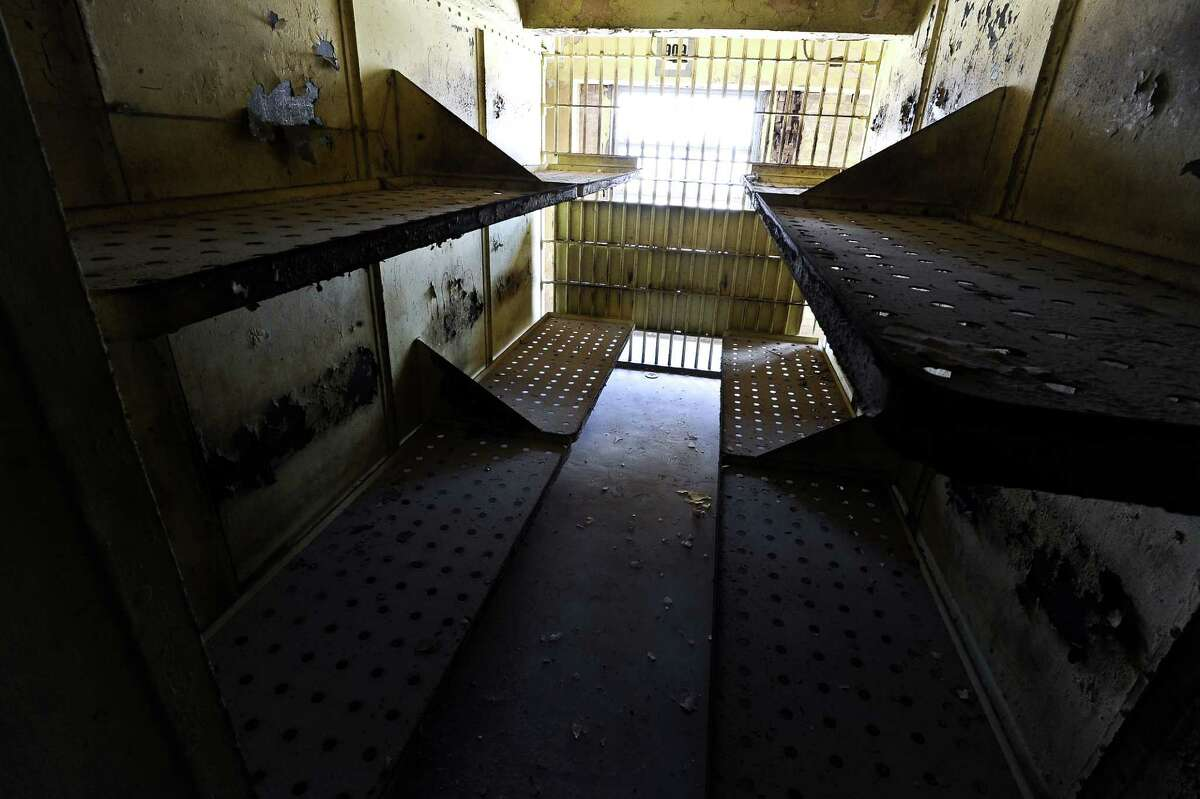 Floors eight through thirteen of the Jefferson County Courthouse once served as the county jail. This came to an end in 1981. The jail is now used for storage by the district clerks office, but the walls still tell a story. Art work and rants left by previous residents fill the walls of these cells, even after the 31 years of vacancy. Photo taken: Randy Edwards/The Enterprise