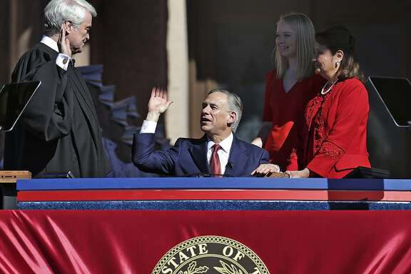 Greg Abbott takes the oath of office during the Inauguration Ceremony of Texas Governor-elect Abbott and Lieutenant Governor-elect Dan Patrick in Austin, Texas.  Tuesday, Jan. 20, 2015.