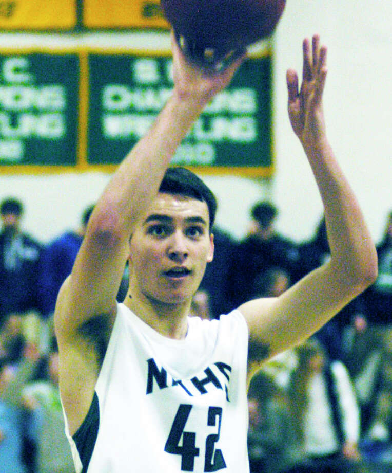Nick Peixoto of the Green Wave shoots a free throw during  New Milford High School boys' basketball's 63-60 victory over Masuk, Jan. 16, 2015 at NMHS. Photo: Norm Cummings / The News-Times