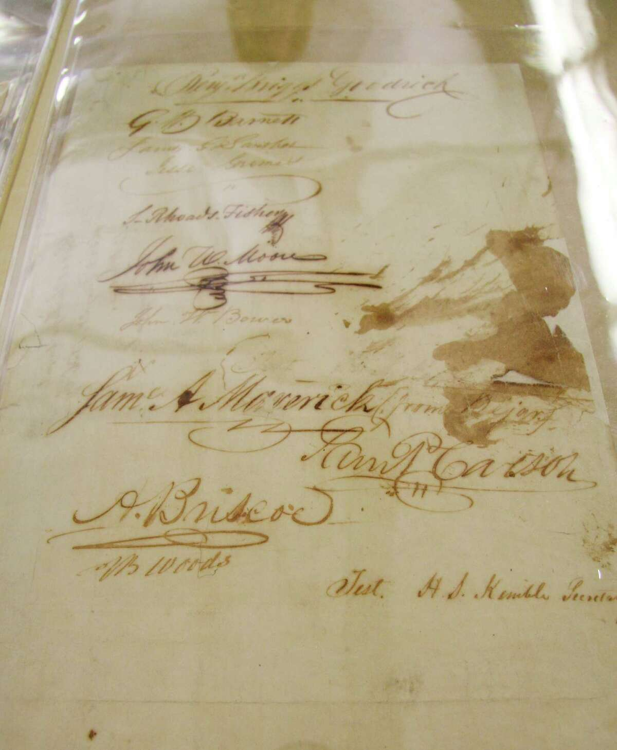 This 2011 file photo shows the last page of the Texas Declaration of Independence, written in 1836 and displayed that year in Austin. Archivists believe the big ink blotch next to the same of Samuel Maverick of San Antonio was caused when someone, perhaps Maverick, knocked over the ink well that was being used by the 59 signers.