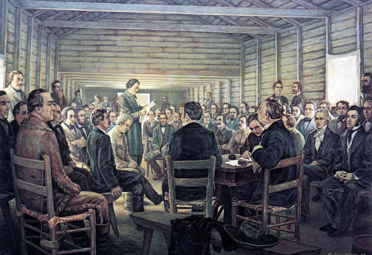 """""""The Reading of the Texas Declaration of Independence,"""" by Charles and Fanny Normann, shows delegates gathered in a one-room building at Washington-on-the-Brazos in East Texas. The portrait is from the collection of the Joe Fultz estate, Navasota. Photo courtesy of the Star of the Republic Museum"""