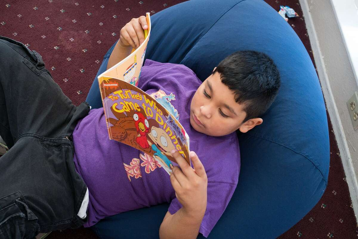 David Resendez, 8, gets lost in a beanbag and a book at the Kids' Reading Room at Hammerly Walk Apartments David Resendez, 8, gets lost in a beanbag and a book at the Kids' Reading Room at Hammerly Walk Apartments
