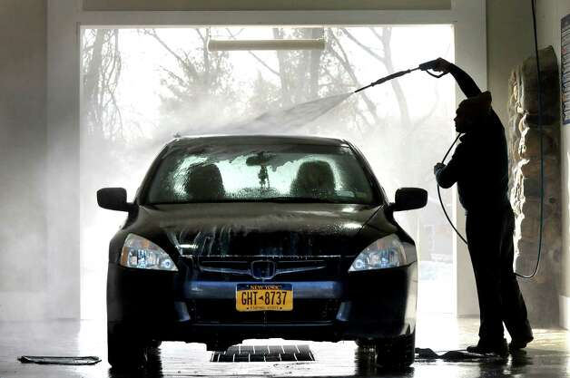 Muhammad Hafeez of Colonie sprays off road salt from his car on Tuesday, Jan. 20, 2015, at Hoffman Car Wash in Colonie, N.Y. (Cindy Schultz / Times Union) Photo: Cindy Schultz / 00030272A