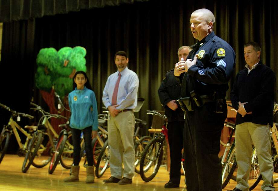 Greenwich Police Sgt. Timothy Hilderbrand speaks to Western Middle School students on Tuesday, January 20, 2015, to thank them for holiday cards sent by the students and to raffle bicycles. Photo: Lindsay Perry / Stamford Advocate