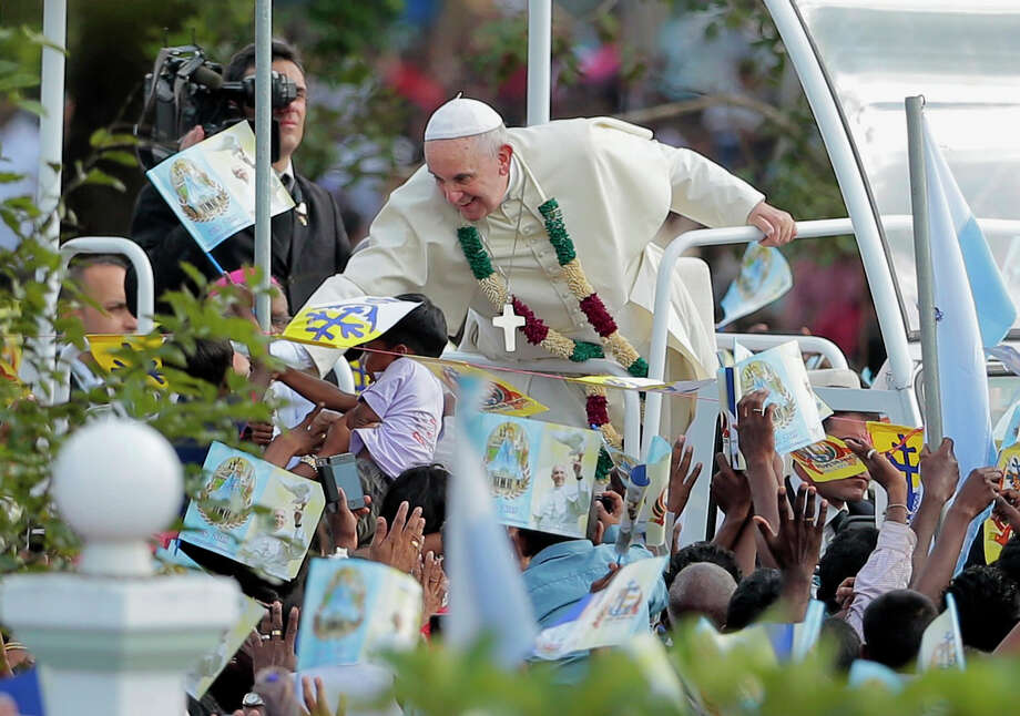 Pope Francis reaches out to his devotees as he arrives at the church of Our Lady of Madhu in Madhu, Sri Lanka. Photo: Eranga Jayawardena / Associated Press / AP