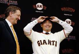 SAN FRANCISCO, CA - JANUARY 20: Larry Baer, President and CEO of the San Francisco Giants introduces Nori Aoki during a press conference at AT&T Park on January 20, 2015 in San Francisco, California.  (Photo by Ezra Shaw/Getty Images)