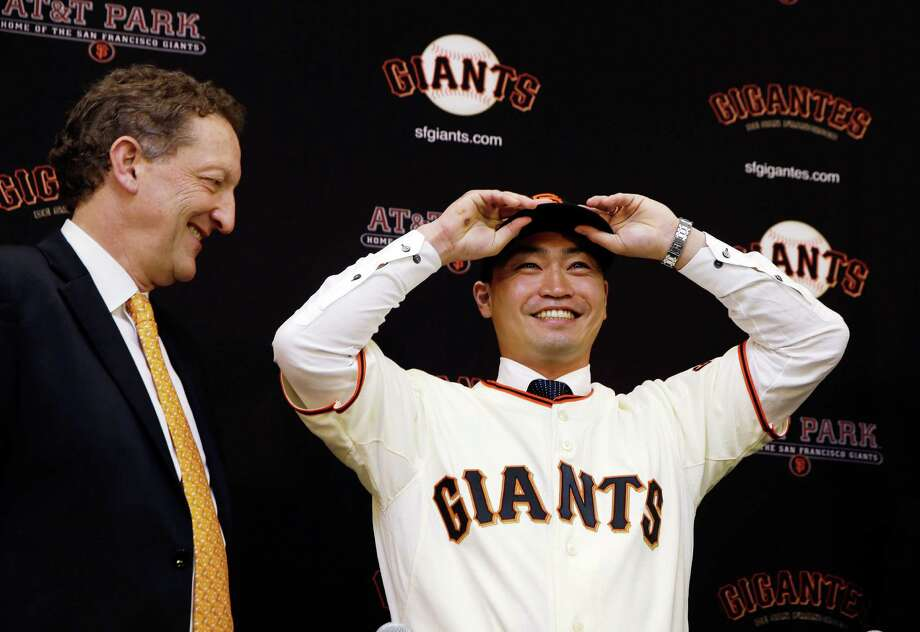 SAN FRANCISCO, CA - JANUARY 20: Larry Baer, President and CEO of the San Francisco Giants introduces Nori Aoki during a press conference at AT&T Park on January 20, 2015 in San Francisco, California.  (Photo by Ezra Shaw/Getty Images) Photo: Ezra Shaw / Getty Images / 2015 Getty Images