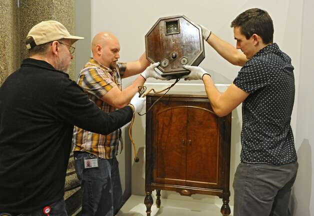 "From left, New York State Museum workers Gregory Brown, Scott Heydrick and Brett Stageman install a 1928 television at the new exhibit titled ""New York's Bold Ideas: Inventions that Changed the Human Condition"" on the second floor of the Capitol on Tuesday, Jan. 20, 2015 in Albany, N.Y. This television set received the broadcast of Governor Al Smith accepting the Democratic Party nomination for President of the United States. (Lori Van Buren / Times Union) Photo: Albany Times Union"