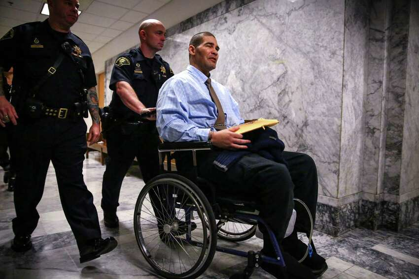Christopher Monfort is wheeled from court as he says,