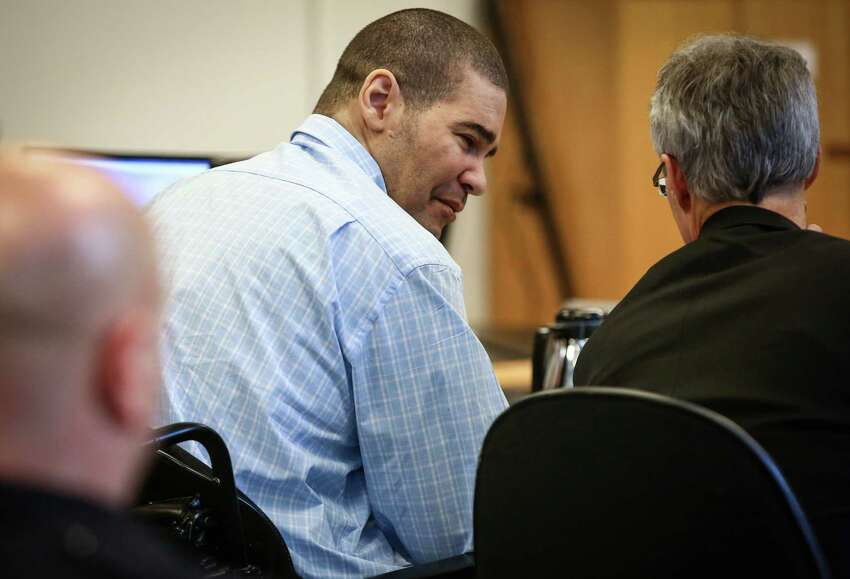Christopher Monfort speaks with one of his attorneys during opening arguments in his trial for the 2009 killing of Seattle Police Officer Timothy Brenton.