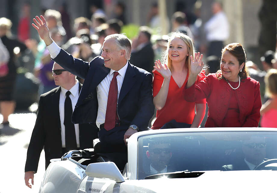 Gov. Greg Abbott, left to right, his daughter Aubrey Abbott, and wife Cecilia Abbott ride in the Inauguration Parade in Austin, Texas.  Tuesday, Jan. 20, 2015. Photo: Bob Owen, San Antonio Express-News / ©2015 San Antonio Express-News