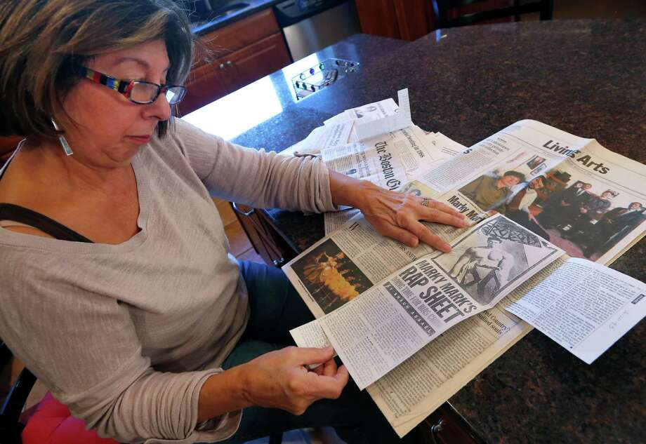 Mary Belmonte, the fourth-grade teacher whose class was harassed by Mark Wahlberg in 1986, looks through old clippings. Photo: Elise Amendola / Associated Press / AP