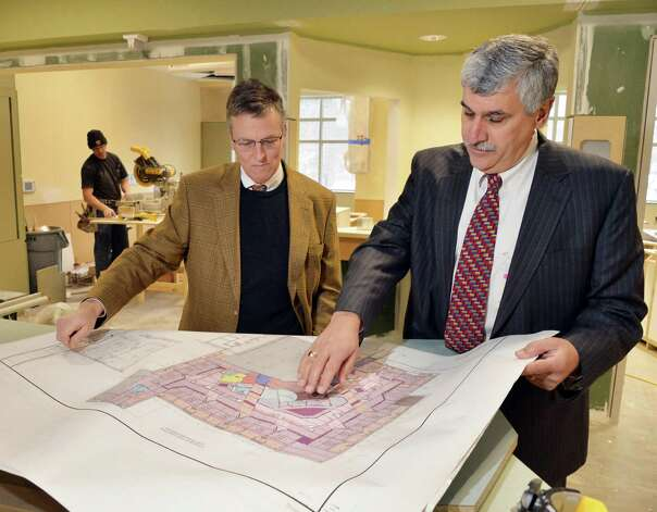President and CEO of Saratoga Hospital, Angelo Calbone, right, and Jim Urner of AOW Associates look over plans for the hospital's new ICU Friday Jan. 16, 2015, in Saratoga Springs, NY.   (John Carl D'Annibale / Times Union) Photo: John Carl D'Annibale / 00030219A