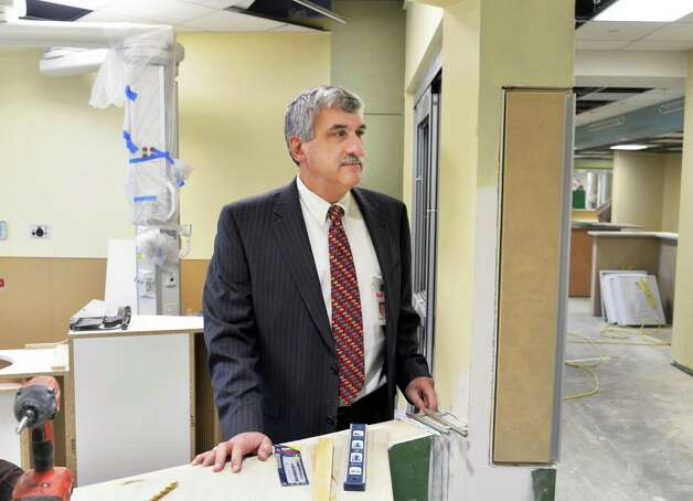 President and CEO of Saratoga Hospital, Angelo Calbone looks over progress on new ICU construction Friday Jan. 16, 2015, in Saratoga Springs, NY.   (John Carl D'Annibale / Times Union) Photo: John Carl D'Annibale / 00030219A