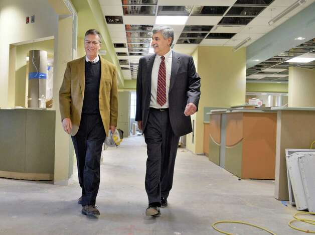President and CEO of Saratoga Hospital, Angelo Calbone, right, and Jim Urner of AOW Associates tour construction of the new ICU Friday Jan. 16, 2015, in Saratoga Springs, NY.   (John Carl D'Annibale / Times Union) Photo: John Carl D'Annibale / 00030219A