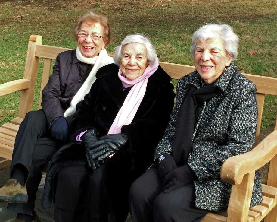 Left to right, Mildred Tiriolo Popp, Mary Tiriolo Provost-Slocum, and Grace Tiriolo LaRusso, sisters who grew up together in Pemberwick, sit on the bench their family donated to Pemberwick Park in their honor. Mary Tiriolo Provost-Slocum turned 103 on Monday, January 19, 2015. Photo: Contributed Photo / Greenwich Time Contributed
