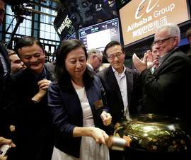 Alibaba Group Chief Financial Officer Maggie Wu and CEO Jack Ma celebrate the company's IPO at the New York Stock Exchange last year.