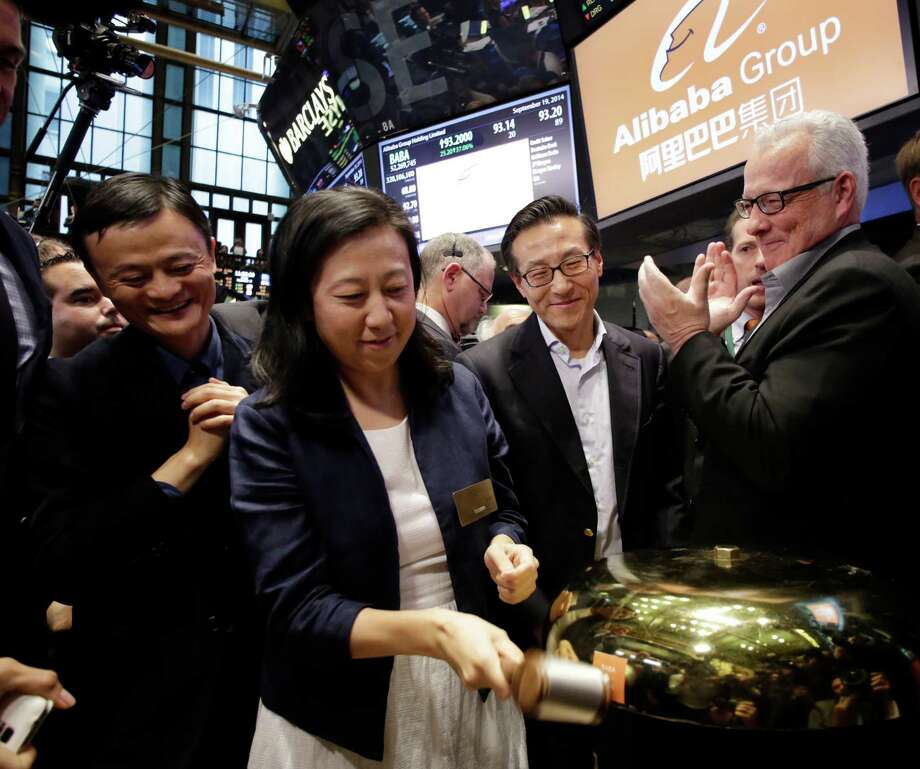 Alibaba Group Chief Financial Officer Maggie Wu and CEO Jack Ma celebrate the company's IPO at the New York Stock Exchange last year. Photo: Mark Lennihan / Associated Press / AP