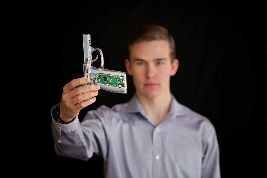 Kai Kloepfer, 17, holds a smart handgun he designed to fire only when it recognizes the fingerprint of a person holding it. Photo: Daniel Borris /New York Times / NYTNS