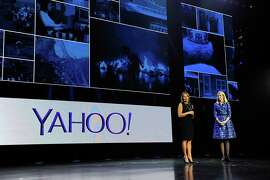 Katie Couric and Yahoo CEO Marissa Mayer attend a news conference at the 2014 Consumer Electronics Show, where Couric and David Pogue, below, were introduced as additions to Yahoo.