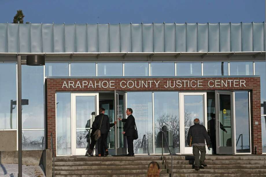 People enter the Arapahoe County Justice Center in Centennial, Colo., as jury selection begins. Photo: Brennan Linsley / Associated Press / AP
