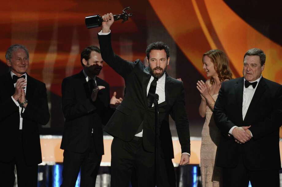 "Ben Affleck (center), who played a Latino in ""Argo,"" accepts an Oscar for the Outstanding Performance by a Cast award. Photo: Mark Davis / Getty Images / 2013 Getty Images"