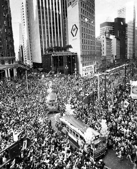 Jan. 26, 1982: The scene was chaotic at the 49ers Super Bowl XVI parade - city leaders expected 25,000 fans, and 500,000 showed up. Look closely and you can see Dwight Clark in a fur coat, as his cable car bus turns Market and Montgomery Streets. Eric Luse took the photo. The talented duo of Luse and Fred Larson accounted for some incredible photography during the 49ers' first Super Bowl year. Photo: Eric Luse, The Chronicle