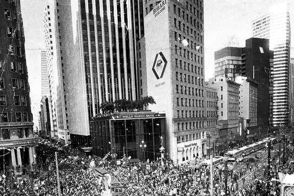 Jan. 26, 1982: The scene was chaotic at the 49ers Super Bowl XVI parade - city leaders expected 25,000 fans, and 500,000 showed up. Look closely and you can see Dwight Clark in a fur coat, as his cable car bus turns Market and Montgomery Streets. Eric Luse took the photo. The talented duo of Luse and Fred Larson accounted for some incredible photography during the 49ers' first Super Bowl year.
