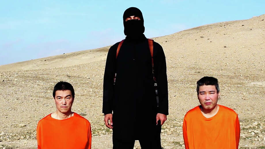 A militant threatens to kill two Japanese hostages unless a $200 million ransom is paid within 72 hours. Photo: Associated Press / Islamic State group