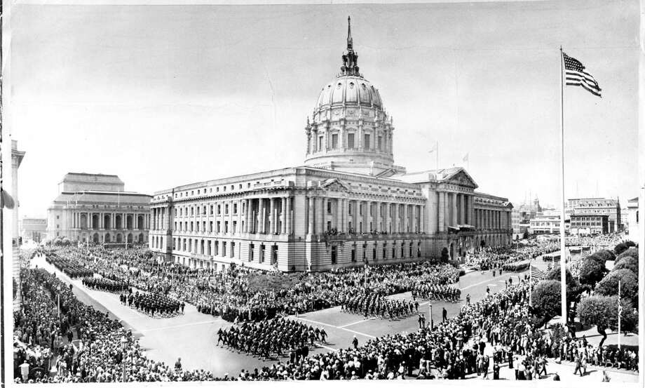 Soldiers march past City Hall on Sept. 9, 1945, during the victory parade celebrating the end of World War II. Leading the parade was Gen. Jonathan M. Wainwright, still extremely thin from years in a Japanese prison camp. The emotional parade brought 500,000 to San Francisco — then the largest parade the city had seen. Photo: Chronicle File / The Chronicle / ONLINE_YES