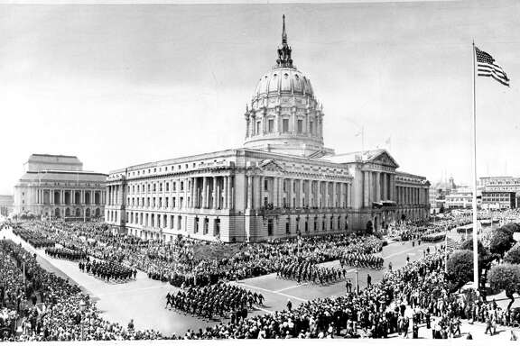 Soldiers march past City Hall on Sept. 9, 1945, during the victory parade celebrating the end of World War II. Leading the parade was Gen. Jonathan M. Wainwright, still extremely thin from years in a Japanese prison camp. The emotional parade brought 500,000 to San Francisco — then the largest parade the city had seen.