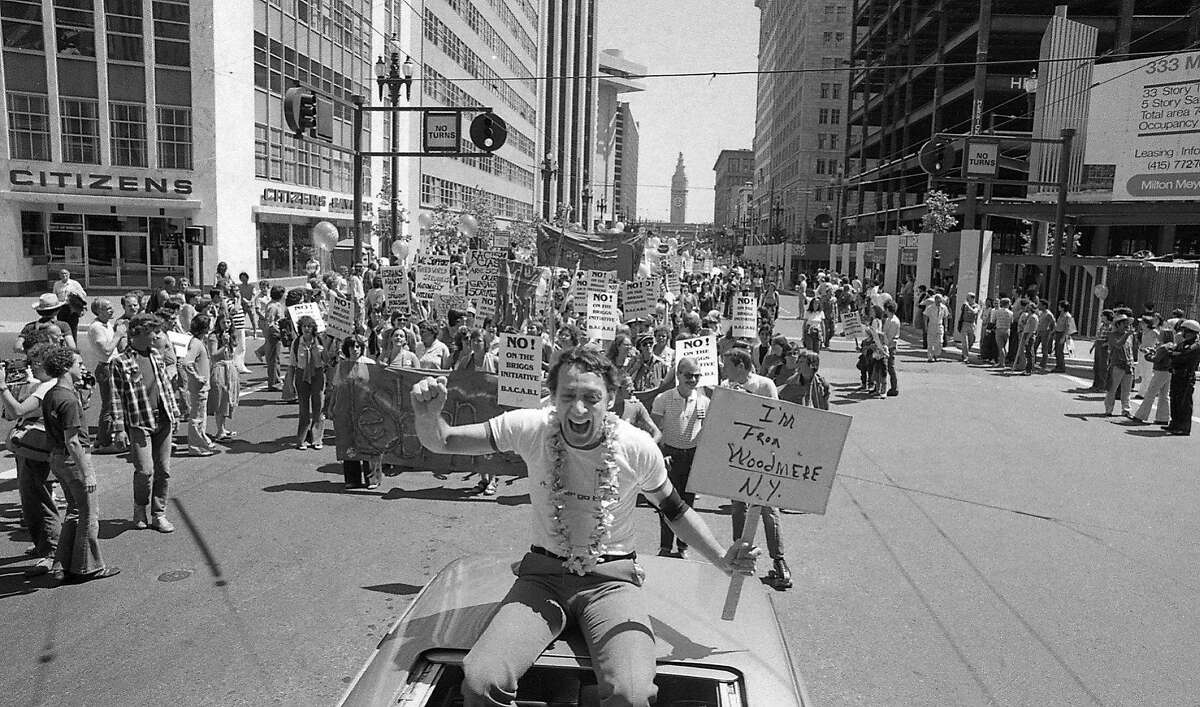 Harvey Milk rides on top of a car on Market St. at the 1978 at the Gay Freedom Day Parade, now known as San Francisco Pride. 06/25/1978 150 anniversary maybe