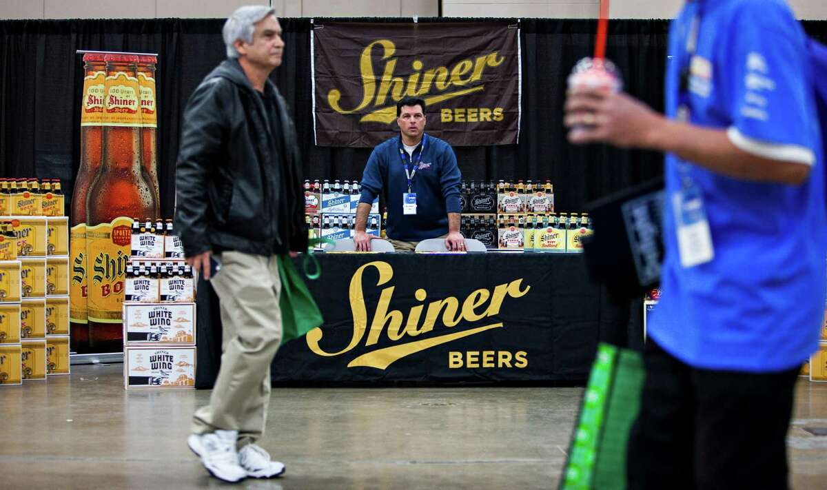 Gambrinus regional chain manager, Rob LaNasa, who is based in San Antonio, sells Shiner beers at the CST Brands Inc. trade show for more than 1,000 store managers held Tuesday in Exhibit Hall A at the Convention Center on Jan 20, 2015.