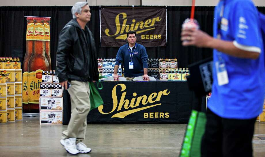 Gambrinus regional chain manager, Rob LaNasa, who is based in San Antonio, sells Shiner beers at the CST Brands Inc. trade show for more than 1,000 store managers held Tuesday in Exhibit Hall A at the Convention Center on Jan 20, 2015. Photo: Spencer Selvidge /For The San Antonio Express-News / © 2014 San Antonio Express-News