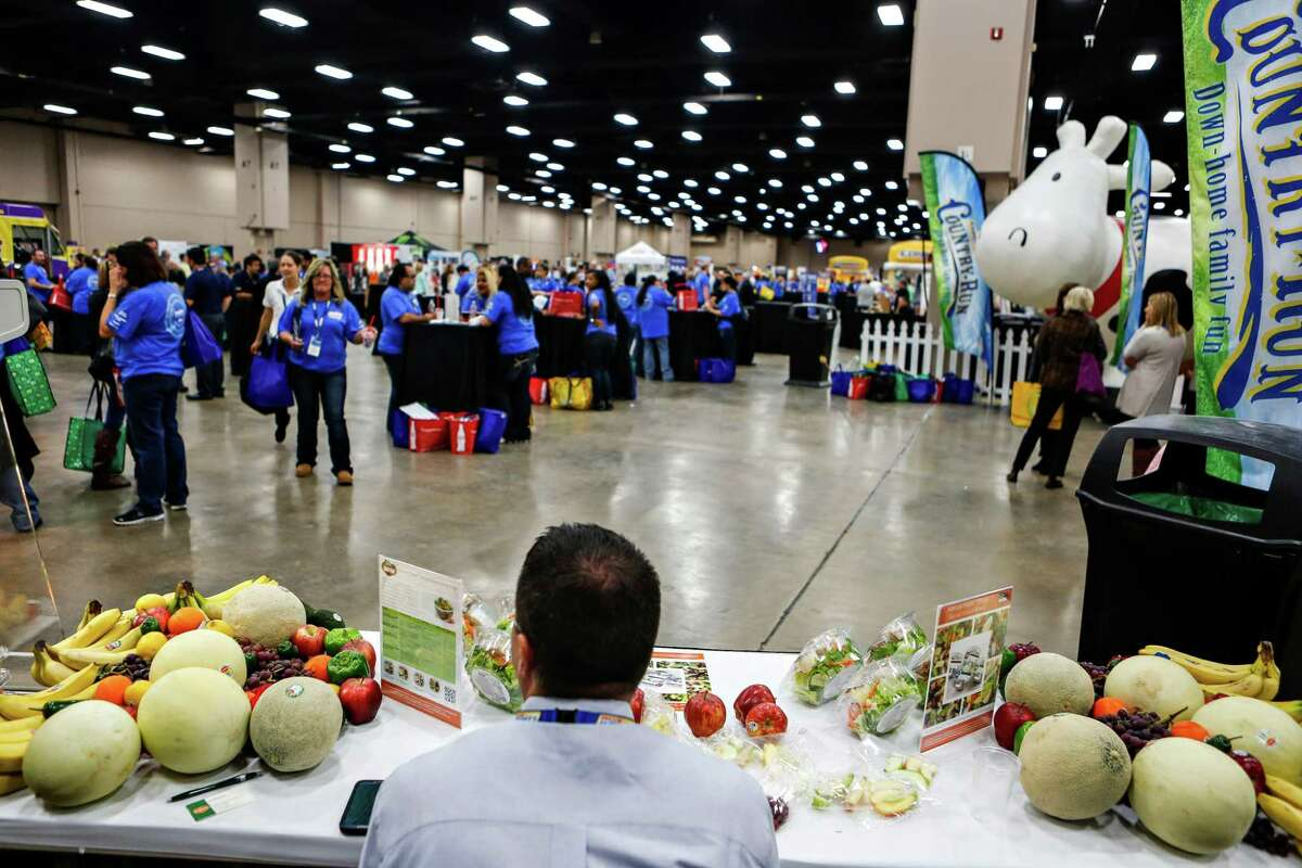 Some of the vendors at the CST Brands Inc. trade show offer samples of fresh salads, vegetables and fruit at the Convention Center.