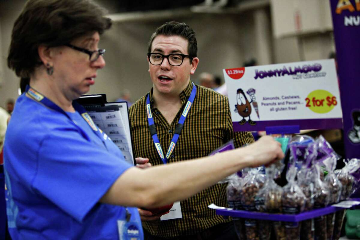 Blake Oliver represents Flint, Mich.-based Jonny Almond Tuesday at the trade show that CST Brands Inc. hosted for its managers of about 1,900 convenience stores across the U.S.