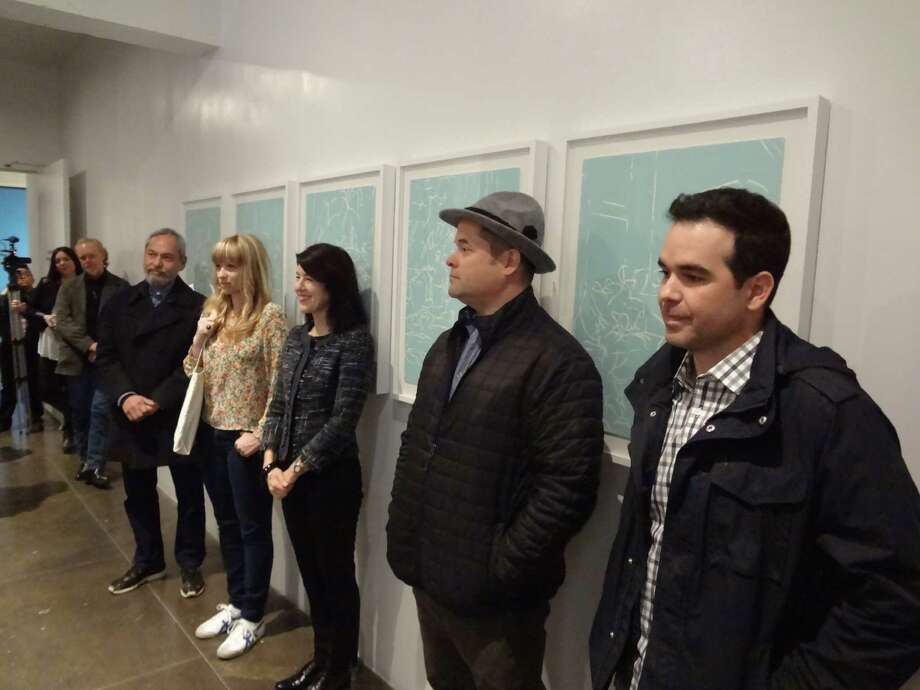 Former Artpace resident artists (from right) Dario Robleto, Nate Cassie, Robyn O'Neil and Jesse Amado are featured in the downtown art space's 20th anniversary exhibition of prints. Former Artpace director Amada Cruz is in the center. Photo: Photo By Francisco Cortes