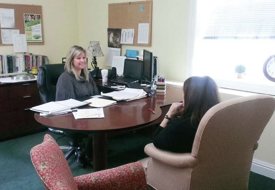 Erin Tishman, left, who was recently named Manager of Clinical Services for New Canaan and Darien for Family Centers, speaks to a client in her Darien office. Photo: Contributed Photo / Greenwich Time Contributed