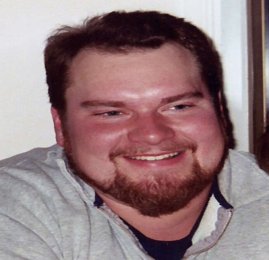 Scott Anderson, pictured in a family photo. Anderson was among six members of his family killed on Christmas Eve 2007. Michele Anderson and Joseph McEnroe have been charged in the killings. Photo: Photos Provided By The King County Prosecutor's Office