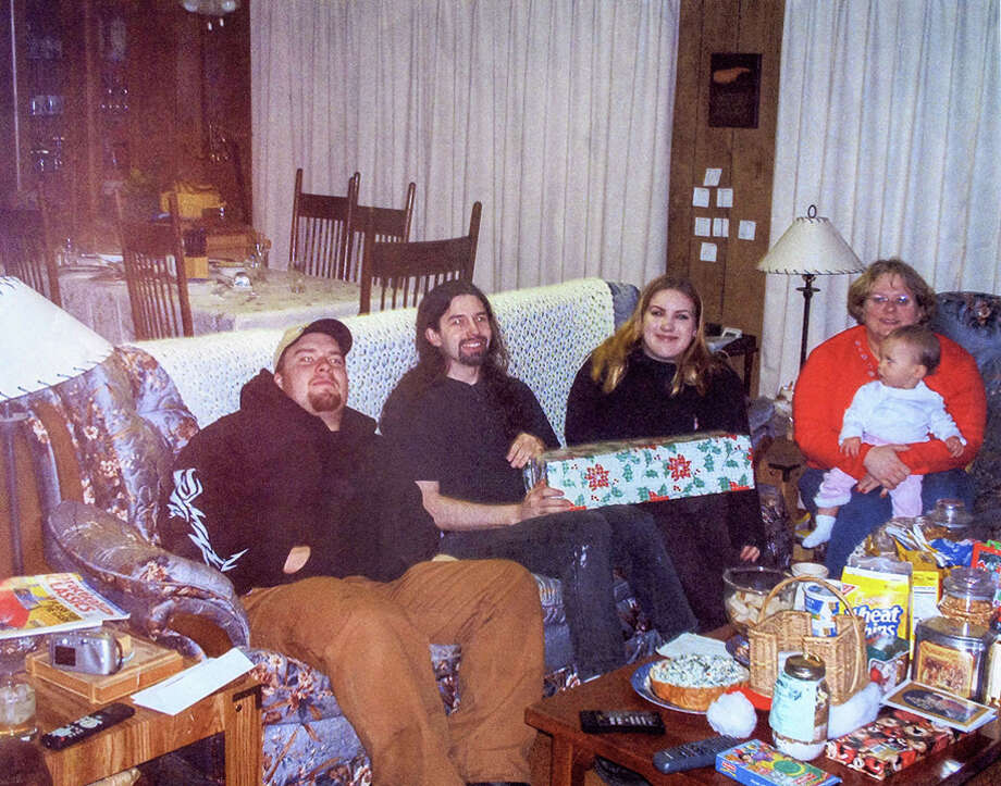From left to right: Scott Anderson, Joseph McEnroe, Michele Anderson, Olivia Anderson and Erica Mantel Anderson, pictured in a 2002 family photo. McEnroe and Michele Anderson are accused of killing Scott Anderson and Erica Mantle Anderson, as well as the couple's daughter Olivia and son Nathan. Photo: Photos Provided By The King County Prosecutor's Office