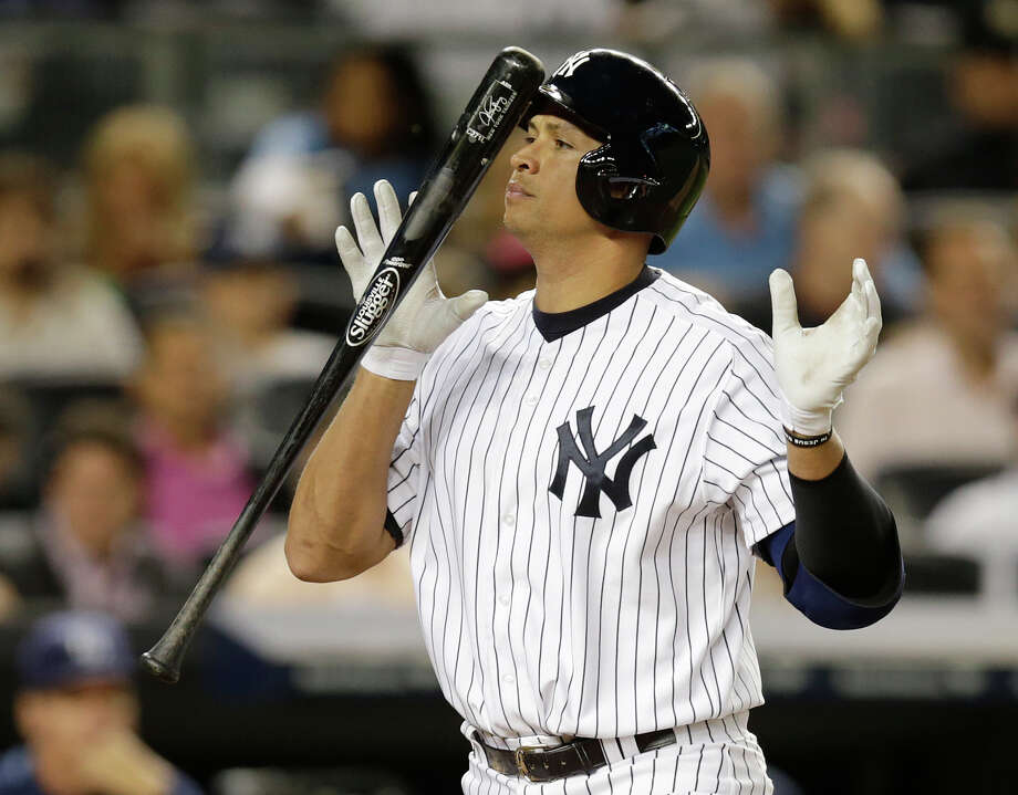 New York Yankees' Alex Rodriguez heads to the dugout after striking out looking in the fifth inning of a baseball game against the Tampa Bay Rays, Wednesday, Sept. 25, 2013, in New York. (AP Photo/Kathy Willens) Photo: Kathy Willens / Associated Press / AP