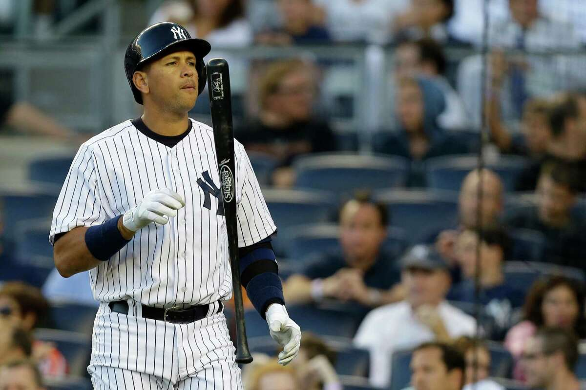 New York Yankees third baseman Alex Rodriguez tosses his bat during a baseball game against the Los Angeles Angels, Wednesday, Aug. 14, 2013, in New York. (AP Photo/Kathy Willens)