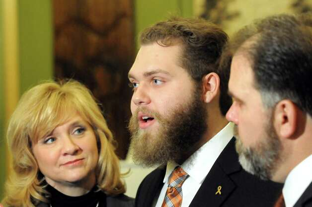 Ryan DeMarco, center, joined by his parents Pam DeMarco, left, and Don DeMarco, speaks to the media after presenting a monetary gift to the Bernard & Millie Duker Children's Hospital through the Tyler DeMarco Foundation on Tuesday, Jan. 20, 2015, at Albany Medical Center in Albany, N.Y. (Cindy Schultz / Times Union) Photo: Cindy Schultz / 00030258A