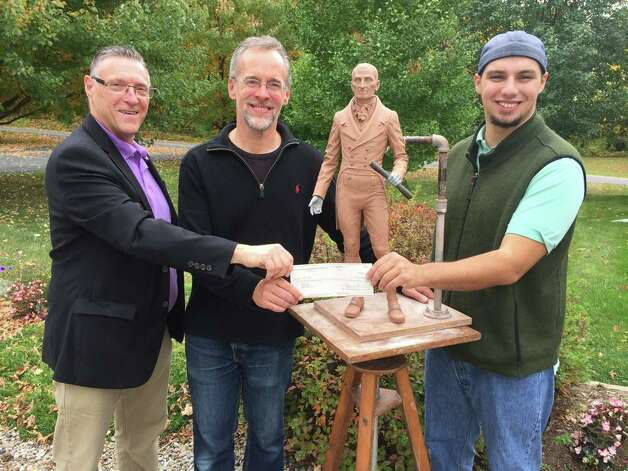 Sculptor Patrick Pigott, center, stands with co-chairs of Pawling Statue Committee Gary Pavlic, left, a Rensselaer County legislator, and Adam Sanzone as they present a check that begins phase II of the project to create a seven-foot statue at Congress Street in time forthe 2016 city bicentennial. They are standing around the competed maqueete, a preliminary model. Other members of the committee are Thomas J. Sanzone, Ken Zalewski, Kathy Sheehan, John Hampshire and Don Rittner.(Submitted photo)